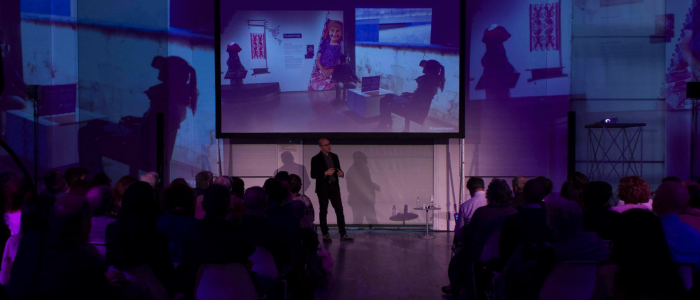 Photo of Corey Timpson speaking to an audience at Triennale di MIlano